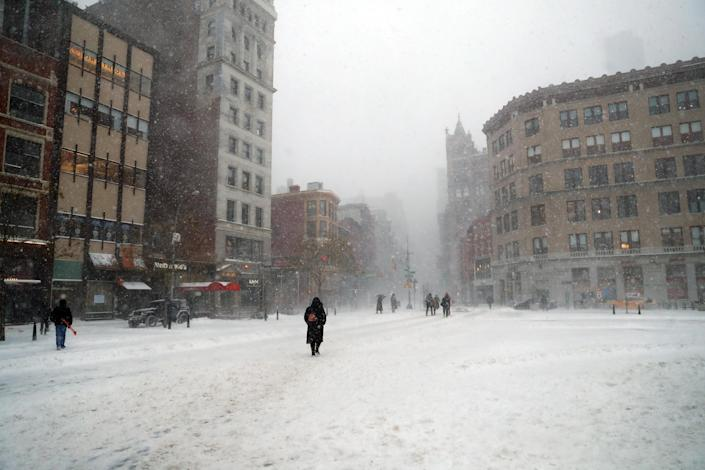 <p>Pedestrian traffic is light in Union Square in New York City during a winter snowstorm on Thursday, Jan. 4, 2018. A massive winter storm swept from the Carolinas to Maine on Thursday, dumping snow along the coast and bringing strong winds that will usher in possible record-breaking cold. (Photo: Gordon Donovan/Yahoo News) </p>