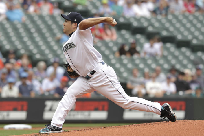 Seattle Mariners starting pitcher Yusei Kikuchi throws during the second inning of a baseball game against the Houston Astros, Wednesday, July 28, 2021, in Seattle. (AP Photo/Jason Redmond)