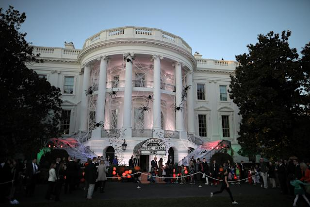 <p>U.S. President Donald Trump and First Lady Melania Trump give out Halloween treats to children at the South Portico of the White House in Washington, D.C. on Oct. 30, 2017. (Photo: Carlos Barria/Reuters) </p>