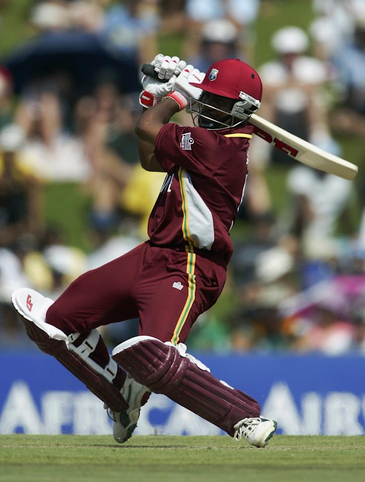 CENTURION - FEBRUARY 23:  Brian Lara of the West Indies hits a boundary during the ICC Cricket World Cup Pool B match between West Indies and Canada held on February 23, 2003 at Supersport Park in Centurion, South Africa.  The West Indies won the match by 7 wickets.  (Photo by Mike Hewitt/Getty Images)