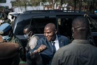 President Faustin Archange Touadera, pictured at a polling station in Bangui, is the frontrunner