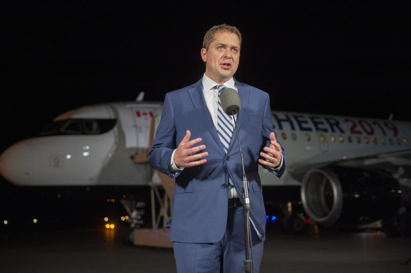"""Federal Conservative leader Andrew Scheer comments on a photo from 2001 surfacing of Canadian Prime Minister and Liberal leader Justin Trudeau, when he was a teacher wearing """"brownface"""" at a party, as he makes a statement on the tarmac in Sherbrooke, Quebec, Wednesday, Sept. 18, 2019. (Frank Gunn/The Canadian Press via AP)"""