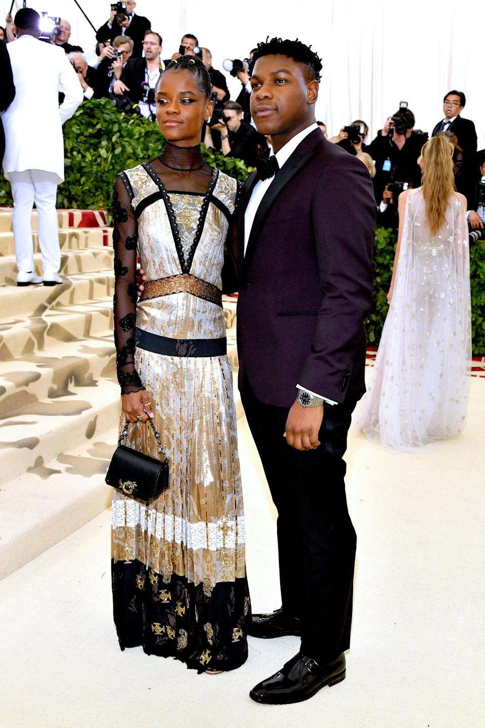 """<h1 class=""""title"""">Letitia Wright in custom Coach and Forevermark jewelry and John Boyega in Michael Kors Collection</h1><cite class=""""credit"""">Photo: Getty Images</cite>"""