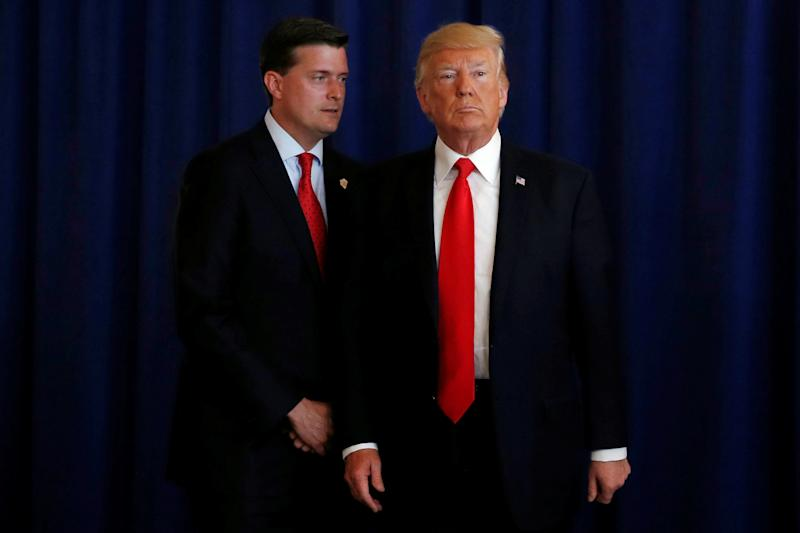 Then-White House staff secretary Rob Porter is seen with President Donald Trump in August. (Jonathan Ernst / Reuters)