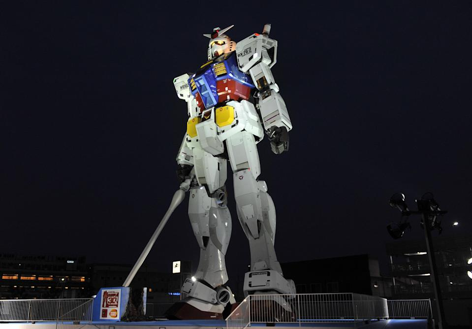 An 18-metre tall statue of popular TV animation hero Gundam is lit up at a park in Shizuoka city, 150km west of Tokyo on July 6, 2010 for a press preview. The huge statue of the life sized robot, which attracted over 3 million spectators in Tokyo last year, will be displayed for the commemoration of the 30th anniversary of the establishment of the Gundam plastic models. The statue will be opened to the public from July 24 through the early next year. AFP PHOTO/YOSHIKAZU TSUNO (Photo credit should read YOSHIKAZU TSUNO/AFP via Getty Images)