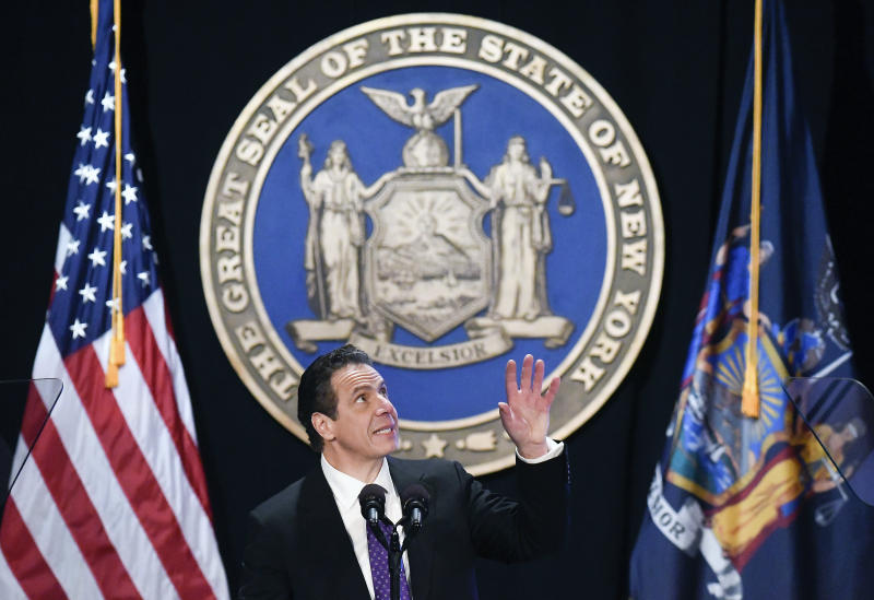 "FILE - In this Wednesday, Jan. 3, 2018 file photo, New York Gov. Andrew Cuomo makes reference to his father Mario Cuomo as he delivers his state of the state address at the Empire State Plaza Convention Center in Albany, N.Y. During the speech, Cuomo pledged to sue over the new federal tax plan, which he called ""an assault"" by the federal government. (AP Photo/Hans Pennink)"