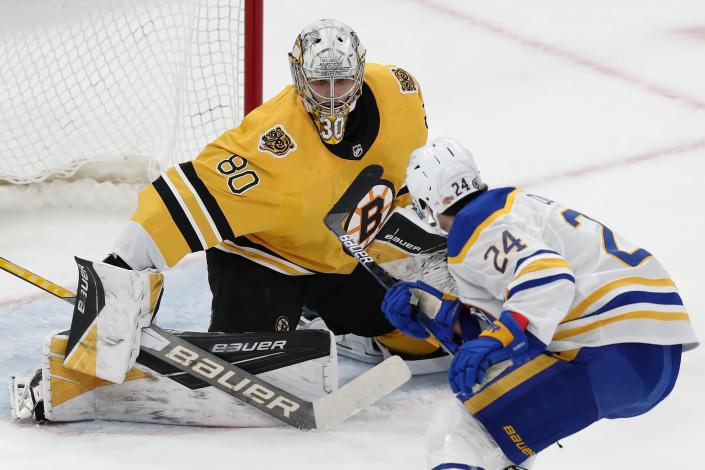 Boston Bruins' Dan Vladar (80) defends against Buffalo Sabres' Dylan Cozens (24) during the first period of an NHL hockey game, Saturday, March 27, 2021, in Boston. (AP Photo/Michael Dwyer)