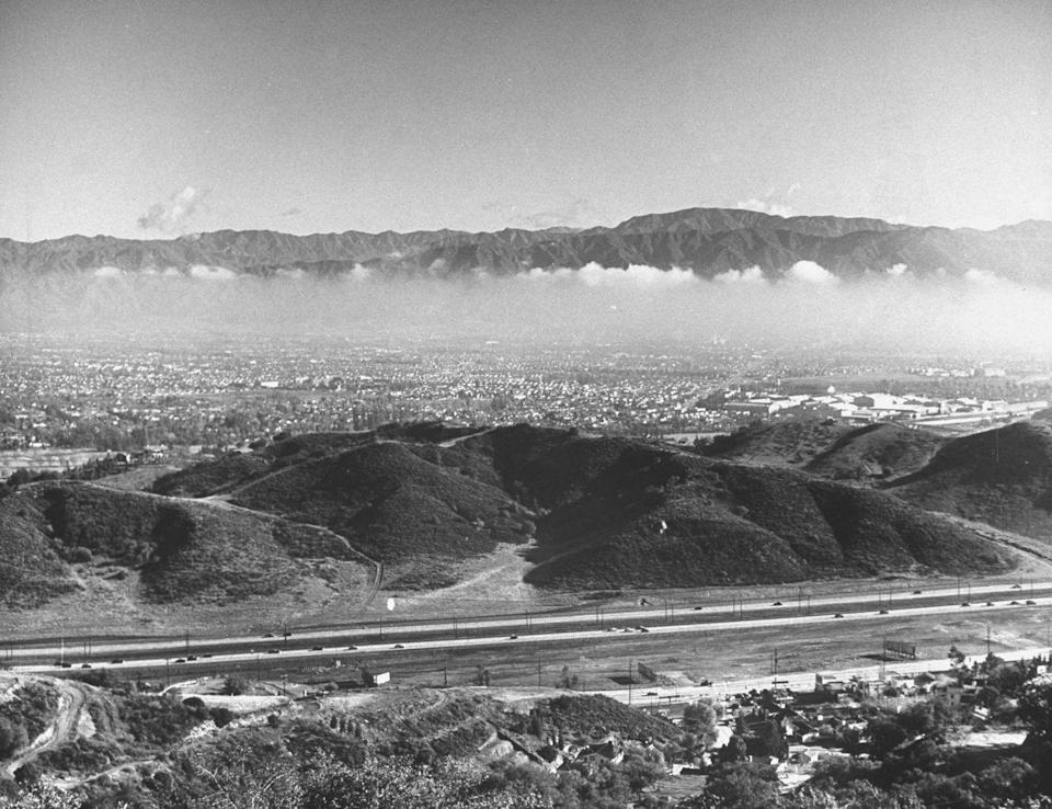 <p>This aerial view of Cahuenga Parkway in the Hollywood Hills is hardly visible, thanks to Los Angeles's serious smog problem (There's more where that came from in the following slides). </p>
