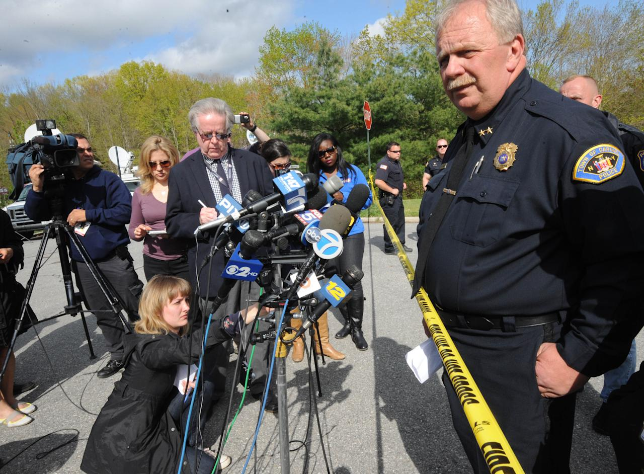 Carmel Police Chief Michael Johnson speaks to the media near the scene of the burnt out house on Wyndham Lane Tuesday May 1, 2012, in New York. The suburban New York home where an intense early morning blaze killed a police captain, his wife and daughters on Tuesday had multiple smoke detectors, but none sent any alarm to a monitoring station, Johnson said. (AP Photo/Louis Lanzano)