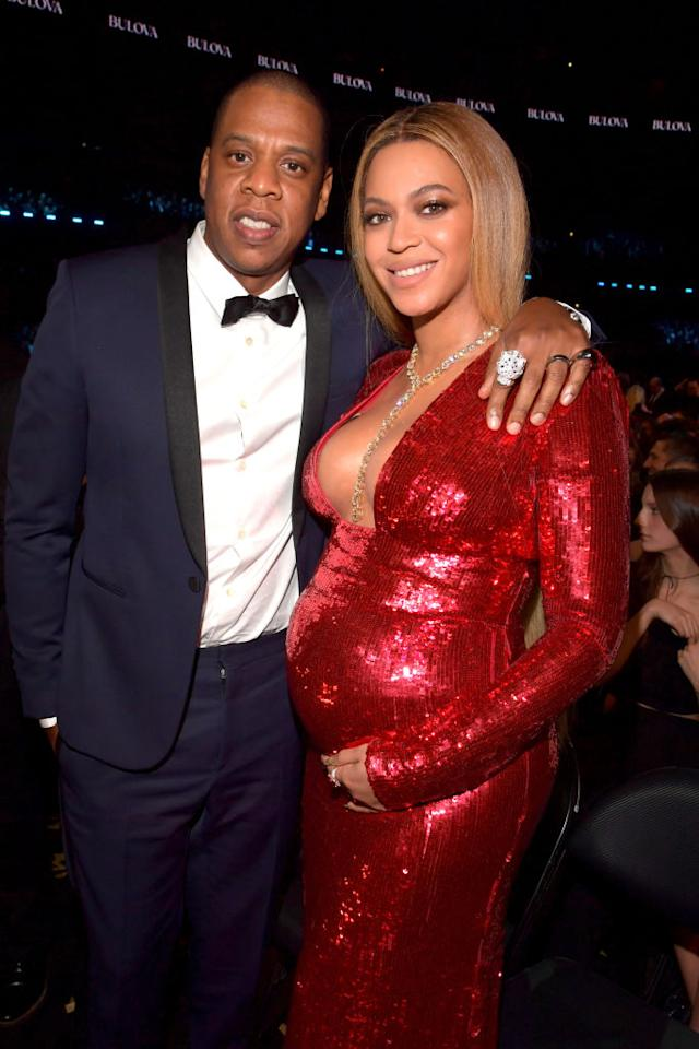 <p>The loved-up couple in an embrace moments after Bey's wardrobe change. Firetruck red sparkles? We're looking this look! <i>(Getty). </i></p>