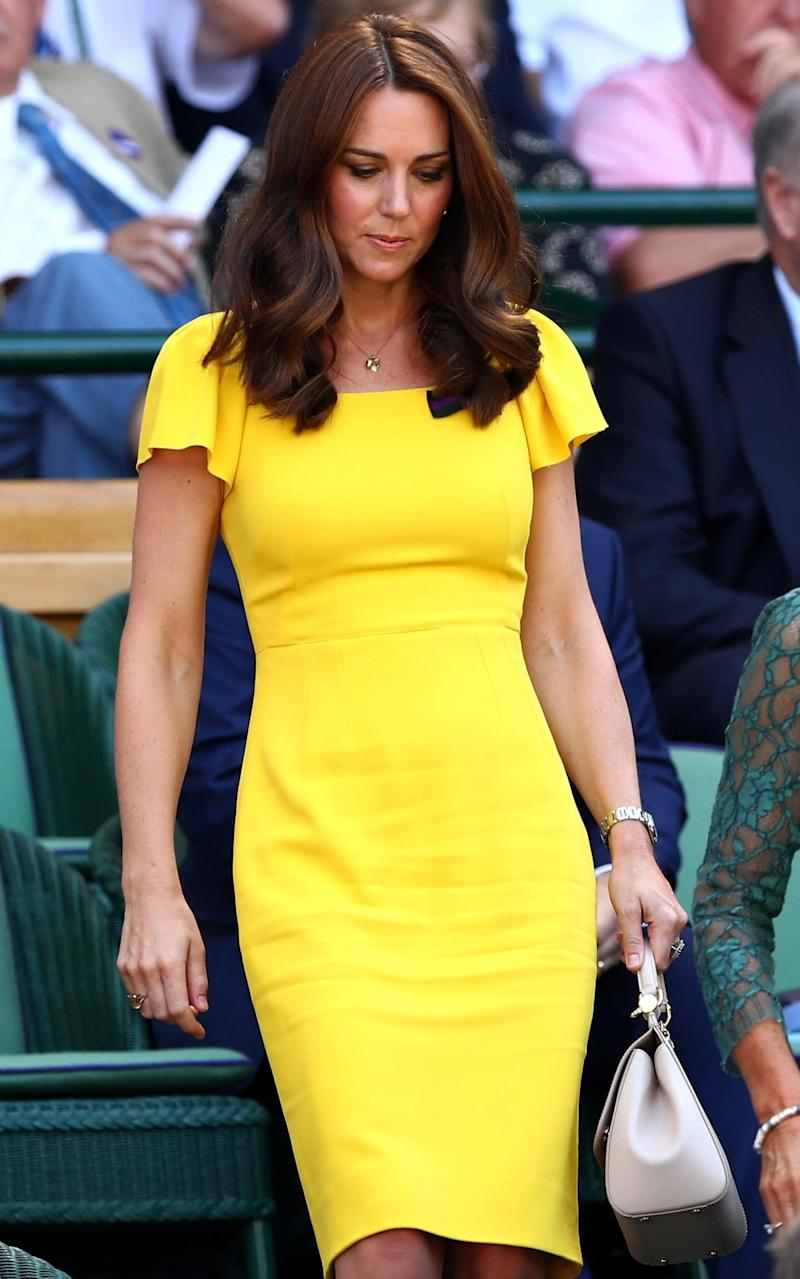 The Duchess of Cambridge arriving at the Wimbledon men's singles final in a Dolce and Gabbana dress and an Asprey necklace - Getty Images Europe