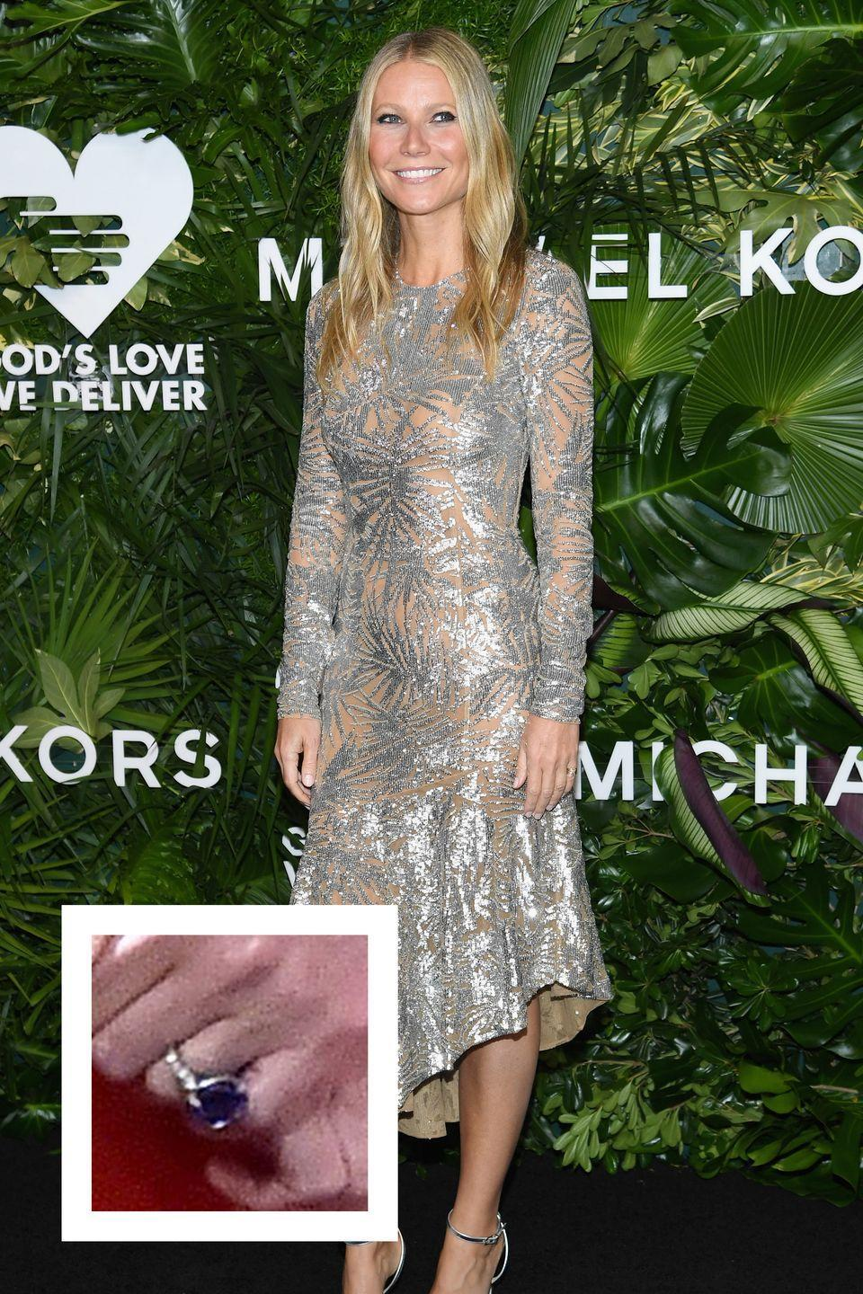 """<p>In early 2018, Paltrow announced her engagement to her boyfriend of three years, <a href=""""https://www.townandcountrymag.com/society/g13858632/brad-falchuk-facts/"""" rel=""""nofollow noopener"""" target=""""_blank"""" data-ylk=""""slk:television writer, director, and producer Brad Falchuk."""" class=""""link rapid-noclick-resp"""">television writer, director, and producer Brad Falchuk.</a> Falchuk proposed <a href=""""https://www.townandcountrymag.com/style/jewelry-and-watches/a15836847/gwyneth-paltrow-engagement-ring/"""" rel=""""nofollow noopener"""" target=""""_blank"""" data-ylk=""""slk:with a massive sapphire engagement"""" class=""""link rapid-noclick-resp"""">with a massive sapphire engagement</a> ring, with a center stone that could be from 10 to 13 carats large, <a href=""""http://time.com/money/5114870/gwyneth-paltrow-engagement-ring-value/"""" rel=""""nofollow noopener"""" target=""""_blank"""" data-ylk=""""slk:Time reports."""" class=""""link rapid-noclick-resp""""><em>Time</em> reports.</a></p>"""
