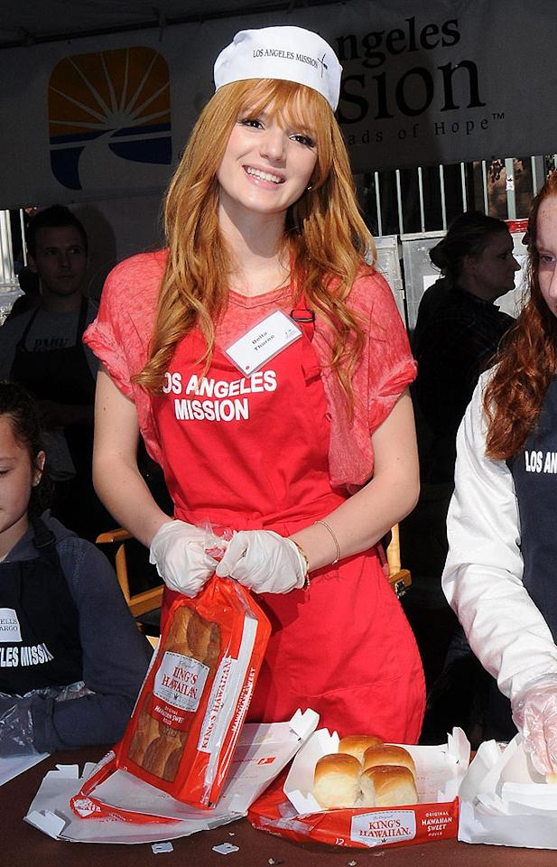 Bella Thorne passes out food for Thanksgiving at the Los Angeles Mission