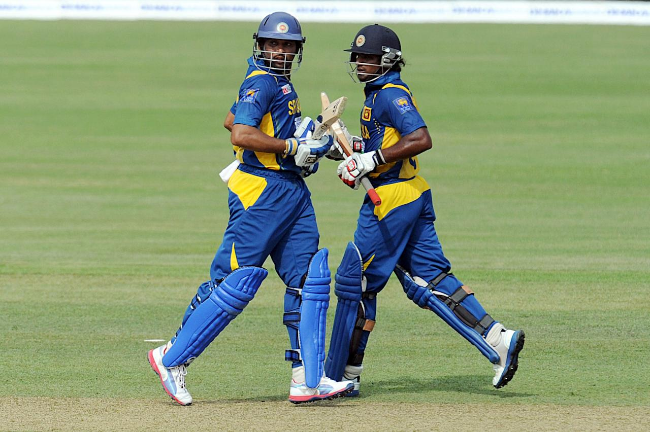 Sri Lankan cricketer Tillakaratne Dilshan (L) and Kushal Janith Perera (R) run between wickets during the third and final one-day international (ODI) match between Sri Lanka and Bangladesh at The  Pallekele International Cricket Stadium in Pallekele on March 28, 2013. AFP PHOTO/ Ishara S. KODIKARA        (Photo credit should read Ishara S.KODIKARA/AFP/Getty Images)