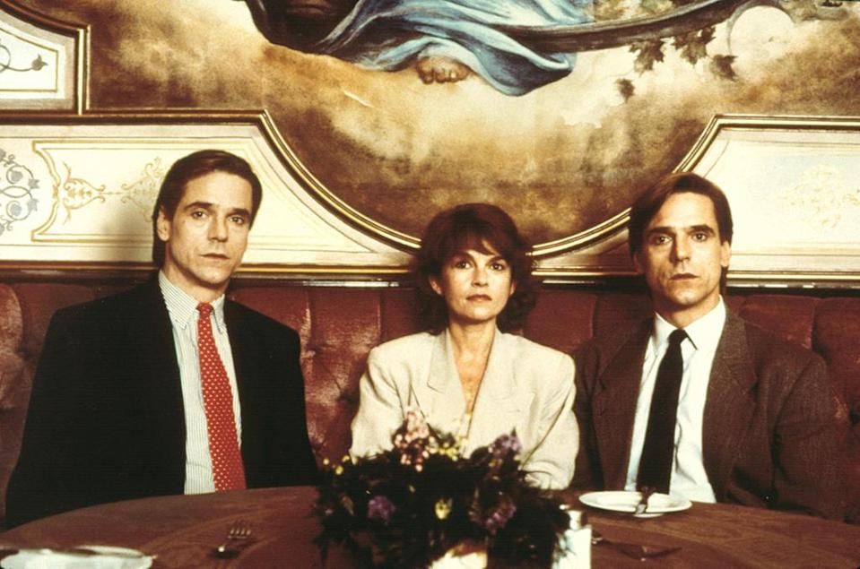<p>In David Cronenberg's 1988 thriller, Irons plays twin doctors who share lovers, taking on each other's respective identities. But they lose sight of their game when they start to squabble over a new paramour, played by Geneviève Bujold. <i>(Photo: Everett Collection)</i></p>