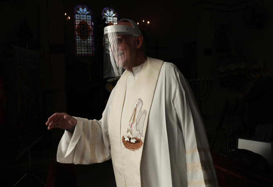 SAO PAULO, BRAZIL - APRIL 19: Father Julio Lancellotti of the Catholic Church walks wearing a face shield mask at the Paroquia Sao Miguel Arcanjo da Mooca amidst the coronavirus (COVID-19) pandemic on April 19, 2020 in Sao Paulo, Brazil. According to the Brazilian Health Ministry, Brazil has 38.654 positive cases of coronavirus (COVID-19) and a total of 2.462 deaths. (Photo by Rodrigo Paiva/Getty Images)