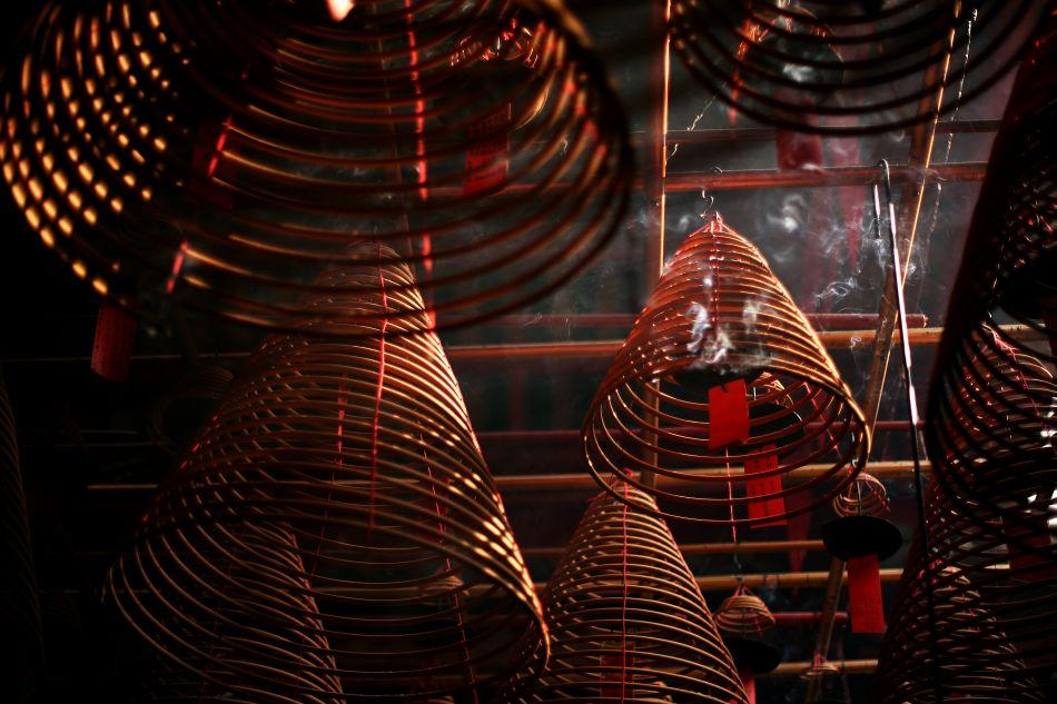 Incense is seen burning inside the Man Mo Temple in Hong Kong. Built by Chinese merchants for the worship of Mo Tai (God of Martial Arts) and Man Cheong (God of Literature) between approximately 1847 and 1862, the Man Mo Temple Compound takes up three blocks consisting of Man Mo Temple, Lit Shing Kung and Kung Sor.