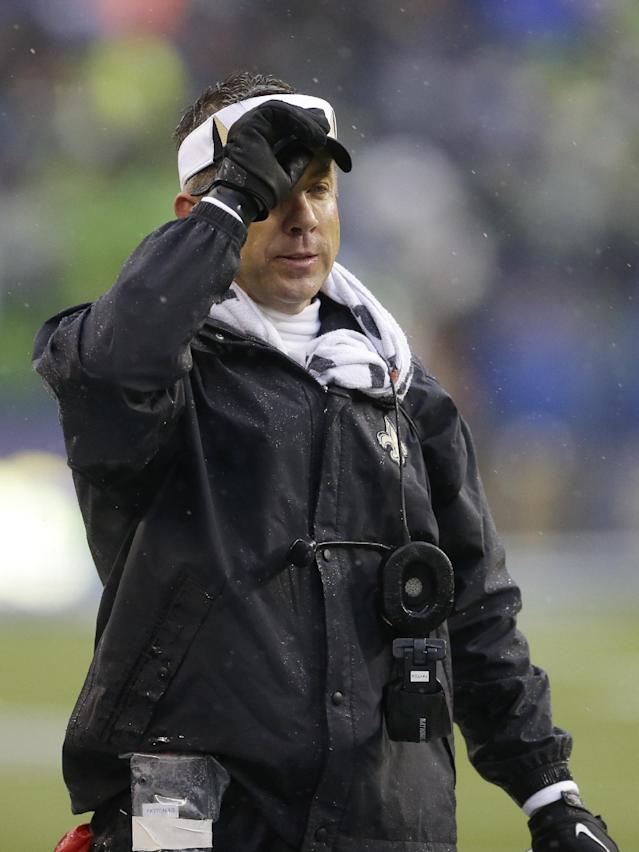 New Orleans Saints coach Sean Payton watches from the sideline during the second quarter of an NFC divisional playoff NFL football game against the Seattle Seahawks in Seattle, Saturday, Jan. 11, 2014. (AP Photo/Ted S. Warren)