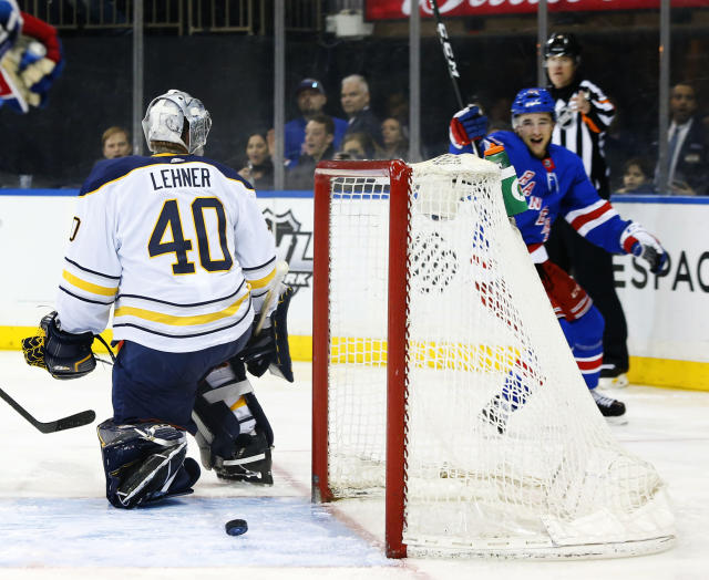 New York Rangers defenseman Neal Pionk, front right, reacts after scoring a goal against Buffalo Sabres goaltender Robin Lehner (40) during second period of an NHL hockey game, Saturday, March 24, 2018, in New York. (AP Photo/Noah K. Murray)