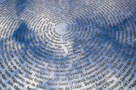 FILE- In this Friday, March 6, 2020, file photo, The sky is reflected in the national MH17 monument which carries the names of the victims of the downed Malaysia Airlines Flight 17 in Vijfhuizen, Netherlands, Friday, March 6, 2020. The trial in absentia in a Dutch courtroom of three Russians and a Ukrainian charged in the downing of Malaysia Airlines flight MH17 in 2014 moves to the merits phase, when judges and lawyers begin assessing evidence. (AP Photo/Peter Dejong, File)