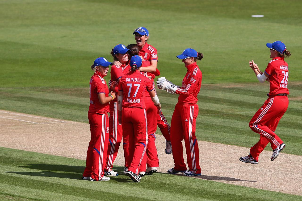 SOUTHAMPTON, ENGLAND - AUGUST 29:  Jenny Gunn of England celebrates with her team-mates after running out Jess Cameron of Australia for 7 runs during the 2nd England NatWest T20 match between England Women and Australia Women at Ageas Bowl on August 29, 2013 in Southampton, England.  (Photo by Paul Gilham/Getty Images)