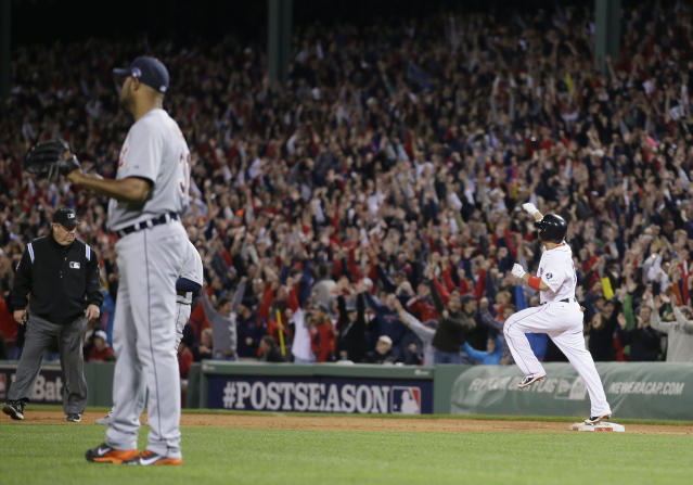 Boston Red Sox's Shane Victorino, right, celebrates his grand slam off Detroit Tigers relief pitcher Jose Veras, left, as he rounds first base in the seventh inning during Game 6 of the American League baseball championship series on Saturday, Oct. 19, 2013, in Boston. (AP Photo/Matt Slocum)