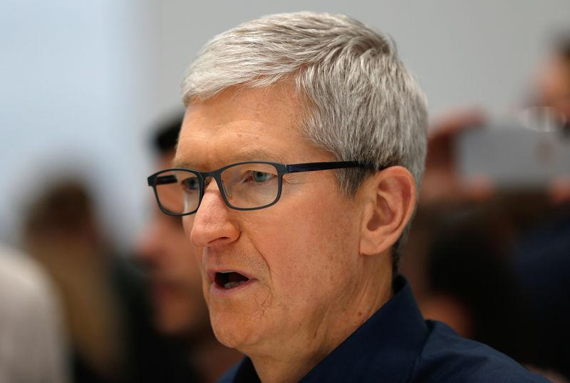 Tim Cook, CEO of Apple, speaks during a demonstration of the newly released Apple products following the launch in Cupertino