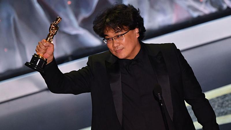 Director Bong Joon-ho accepts best Director before the whole film takes out the Best Film gong at the 2020 Oscars. Photo: Getty Images