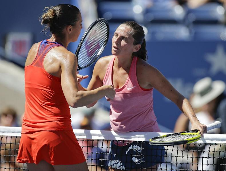 Flavia Pennetta, of Italy, left, greets Roberta Vinci, of Italy, at the net after winning their quarterfinal match of the 2013 U.S. Open tennis tournament, Wednesday, Sept. 4, 2013, in New York. (AP Photo/Kathy Willens)