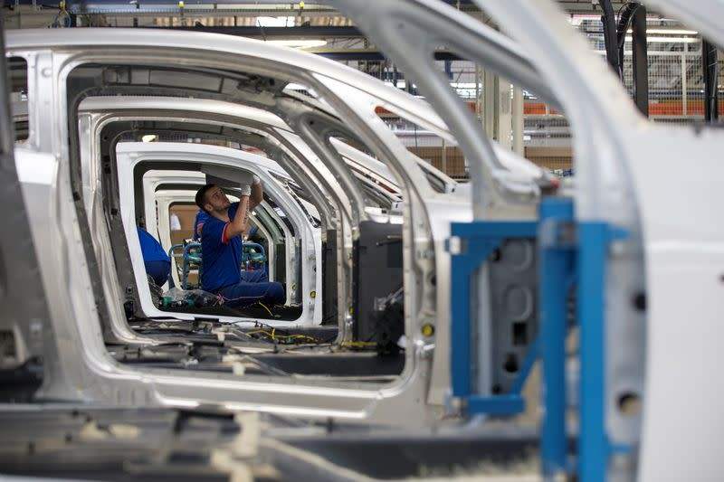 FILE PHOTO: An employee works on the automobile assembly line of Bluecar electric city cars at Renault car maker factory in Dieppe, western France