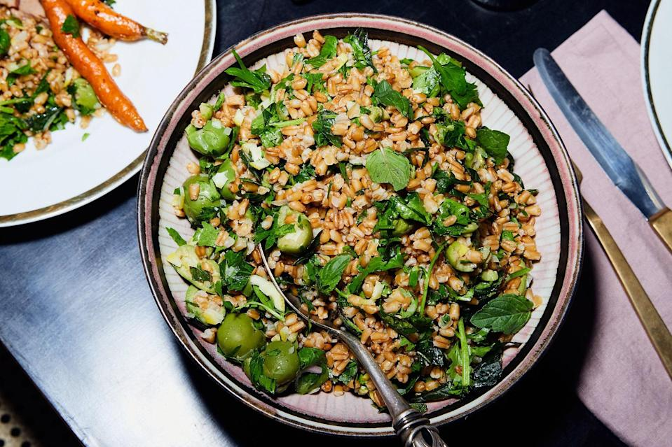 "The buttery flesh and mild flavor of Castelvetrano olives are the perfect addition to this hearty fall salad. Both the grains and the dressing can be made ahead, so consider a double batch on Sunday to get you through next week. <a href=""https://www.epicurious.com/recipes/food/views/grain-salad-with-olives-and-whole-lemon-vinaigrette?mbid=synd_yahoo_rss"" rel=""nofollow noopener"" target=""_blank"" data-ylk=""slk:See recipe."" class=""link rapid-noclick-resp"">See recipe.</a>"