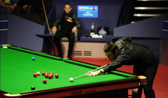 Ronnie O'Sullivan of England plays a shot during the second session of the World Championship Snooker final against Ali Carter of England at the Crucible Theatre in Sheffield, England on May 7, 2012. AFP PHOTO/PAUL ELLISPAUL ELLIS/AFP/GettyImages