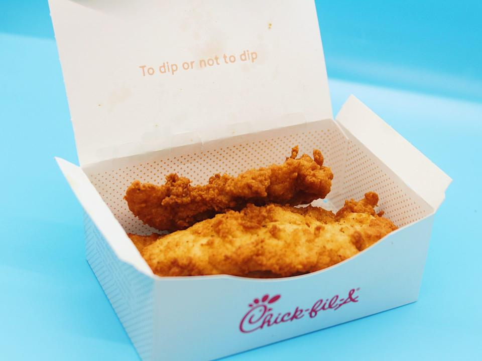 chick fil a chicken tenders in box on blue background
