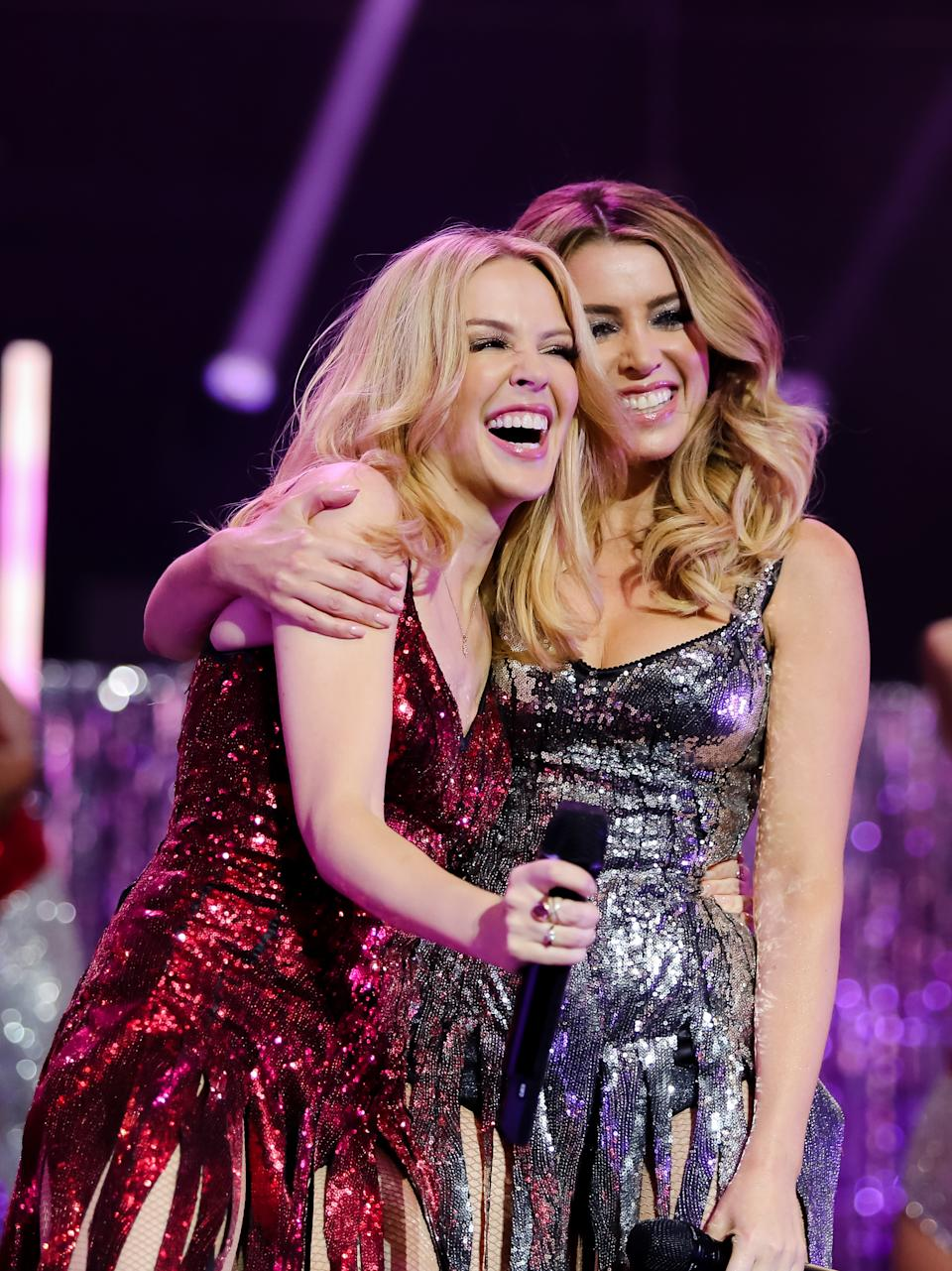 Kylie Minogue is joined by Dannii Minogue on stage during her Christmas show at the Royal Albert Hall on December 11, 2015 in London, England