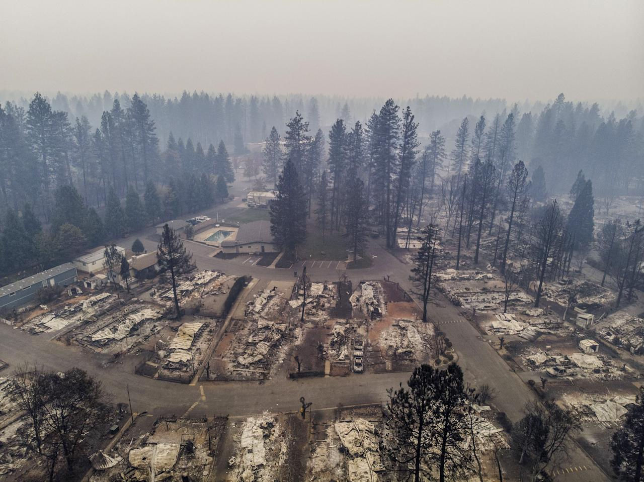 <p>Most of the homes at the Pine Grove Mobile Home Park were destroyed by the Camp Fire that ran through Paradise and surrounding communities, Nov. 13, 2018. (Photo: Hector Amezcua/Sacramento Bee via ZUMA Wire) </p>