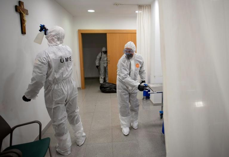 troops had carried out deep-clean operations in more than 100 hospital, 16 prisons and 1,083 old people's homes.  (AFP Photo/Josep LAGO)