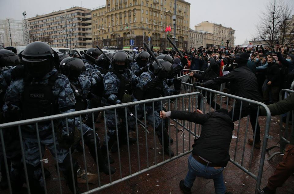 "<span class=""caption"">Russian police officers beat people protesting the jailing of opposition leader Alexei Navalny, Jan. 23, 2021 in Moscow.</span> <span class=""attribution""><a class=""link rapid-noclick-resp"" href=""https://www.gettyimages.com/detail/news-photo/russian-policemen-beat-participants-of-an-unauthorized-news-photo/1230750514?adppopup=true"" rel=""nofollow noopener"" target=""_blank"" data-ylk=""slk:Mikhail Svetlov/Getty Images)"">Mikhail Svetlov/Getty Images)</a></span>"