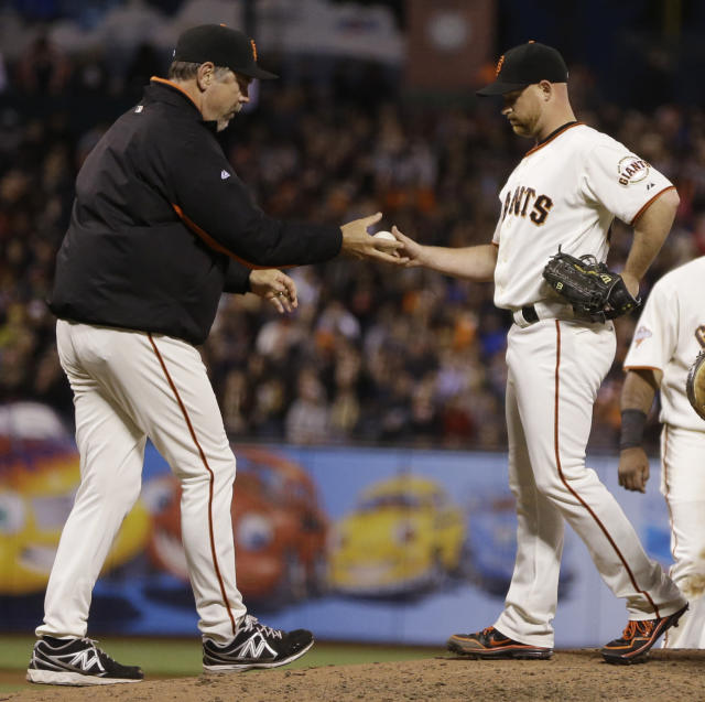 San Francisco Giants' Chad Gaudin, right, is removed from the baseball game against the Cincinnati Reds by manager Bruce Bochy, left, in the fourth inning Wednesday, July 24, 2013, in San Francisco. (AP Photo/Ben Margot)