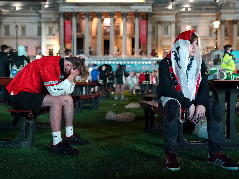 Dejection at Trafalgar Square after England lose (PA)