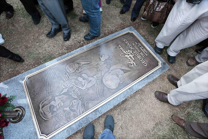 People view the grave marker of country music star George Jones after it was unveiled along with a monument Monday, Nov. 18, 2013, in Nashville, Tenn. Jones died April 26. (AP Photo/Mark Humphrey)