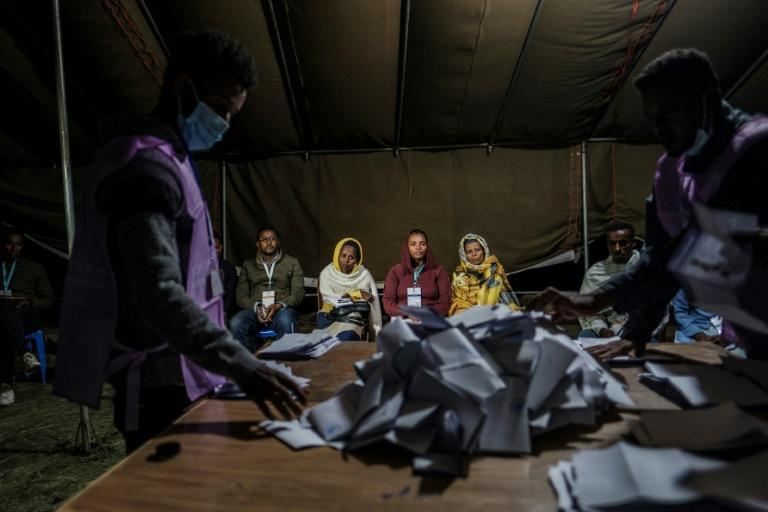 Ballots were being tallied in some of the nearly 50,000 polling stations, with results not expected for several days
