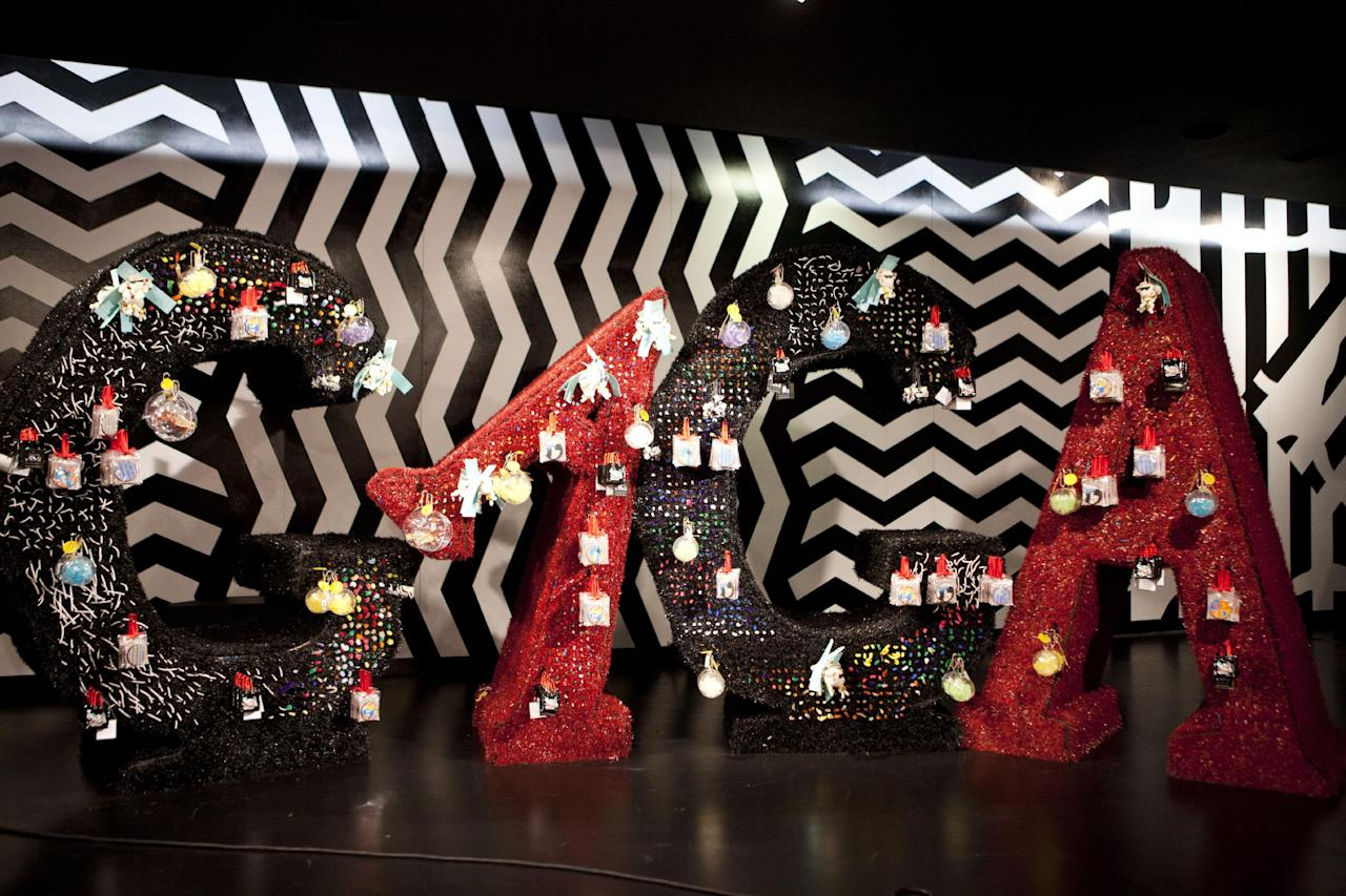 "Ornaments and accessories hang on a display spelling ""GAGA"" at Gaga's Workshop, a collaborative fashion and lifestyle project between Lady Gaga and Barney's New York, at the Barney's store on East 60th Street in New York on Monday, Nov. 21, 2011. (AP Photo/Andrew Burton)"