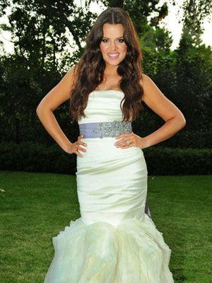"""<p>Following her one-month whirlwind romance with Basketball star Lamar Odom, the couple wed in September 2008. Pictured in a Wang gown, the mermaid tail coupled with a purple-jeweled sash accentuated Khloe's slim waist and sexy curves.  <a rel=""""nofollow"""" href=""""http://au.lifestyle.yahoo.com/fashion/galleries/photo/-/9873746/miami-heats-up-with-swimwear-show/9873353/"""">PICS: Miami heats up with swimwear show</a></p>"""