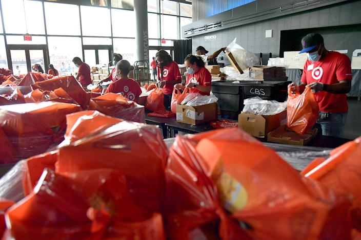 New Yorkers in need receive free produce, dry goods, and meat at a Food Bank For New York City distribution event at Barclays Center on July 30, 2020 in New York City.. (Photo by Michael Loccisano/Getty Images for Food Bank For New York City)