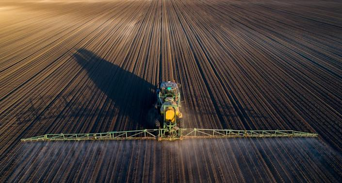 """<span class=""""caption"""">Monocultures are not good socially or environmentally.</span> <span class=""""attribution""""><a class=""""link rapid-noclick-resp"""" href=""""https://www.shutterstock.com/image-photo/aerial-image-tractor-spraying-soil-young-1074836360?src=RgdGfTGt4f-SGAXlWE8hXg-1-57"""" rel=""""nofollow noopener"""" target=""""_blank"""" data-ylk=""""slk:Budimir Jevtic/Shutterstock.com"""">Budimir Jevtic/Shutterstock.com</a></span>"""