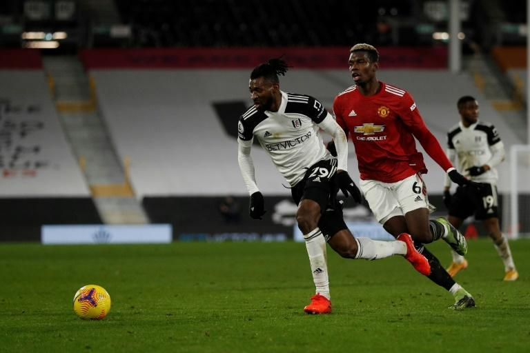 Andre-Frank Zambo Anguissa (L) in action against Paul Pogba and Manchester United earlier this season