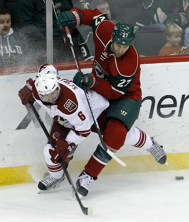 Minnesota Wild left wing Mike Rupp (27) checks Phoenix Coyotes defenseman David Schlemko (6) off the puck during the first period of an NHL hockey game in St. Paul, Minn., Wednesday, Nov. 27, 2013. (AP Photo/Ann Heisenfelt)