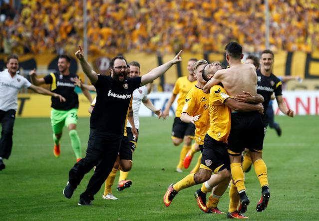 Football Soccer - Dynamo Dresden v RB Leipzig - German Cup (DFB Pokal) - DDV-Stadion, Dresden, Germany - 20/08/16. Dynamo Dresden's Aias Aosman (front R) and his team mates celebrate after he scored the final penalty. REUTERS/Axel Schmidt. DFB RULES PROHIBIT USE IN MMS SERVICES VIA HANDHELD DEVICES UNTIL TWO HOURS AFTER A MATCH AND ANY USAGE ON INTERNET OR ONLINE MEDIA SIMULATING VIDEO FOOTAGE DURING THE MATCH.