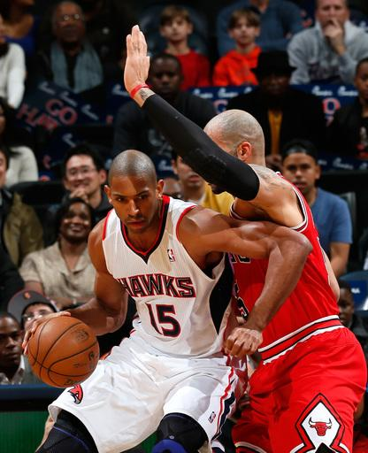 ATLANTA, GA - DECEMBER 22:  Al Horford #15 of the Atlanta Hawks drives against Carlos Boozer #5 of the Chicago Bulls at Philips Arena on December 22, 2012 in Atlanta, Georgia.  (Photo by Kevin C. Cox/Getty Images)