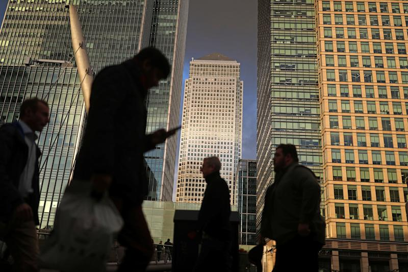 People walk through the Canary Wharf financial district of London, Britain, December 7, 2018. REUTERS/Simon Dawson